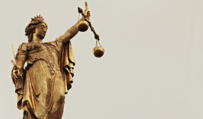 Lady Justice in gold legal writing.jpg